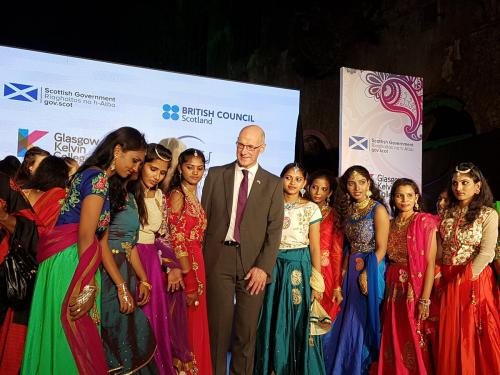 John Swinney with Indian women in saris