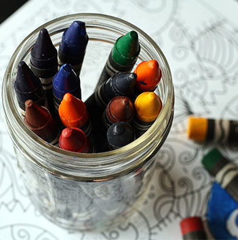 Colouring crayons in a jar