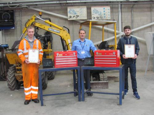 Students and lecturer with awards and toolboxes