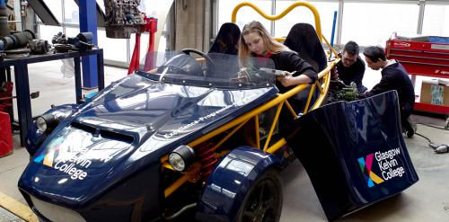 Students working on kit car