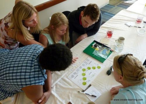 Adults and children looking at learning materials
