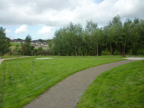 Grassed areas and path