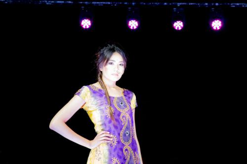 Model in sari inspired dress