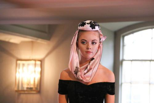 Model in pink hat with scarf