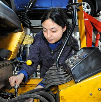 Female working on car engine