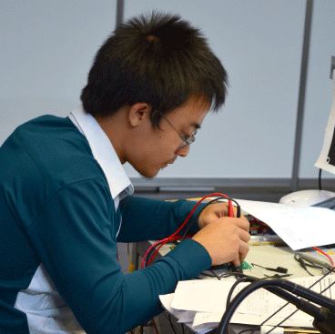 Student working on electronics
