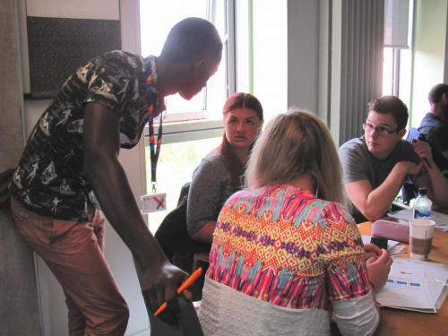 Serign is pictured supporting a group of students at a recent Market Maker ideas session.